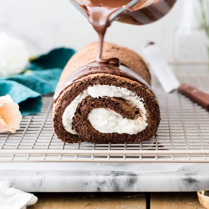 Pouring chocolate over chocolate roulade