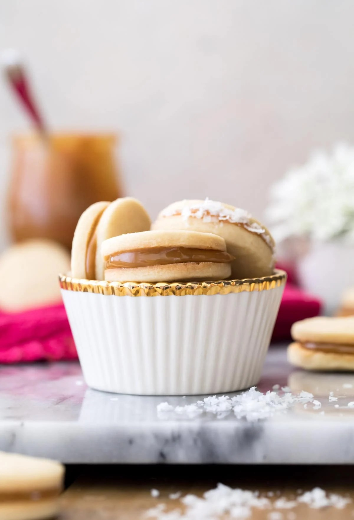 stack of alfajores in white cup