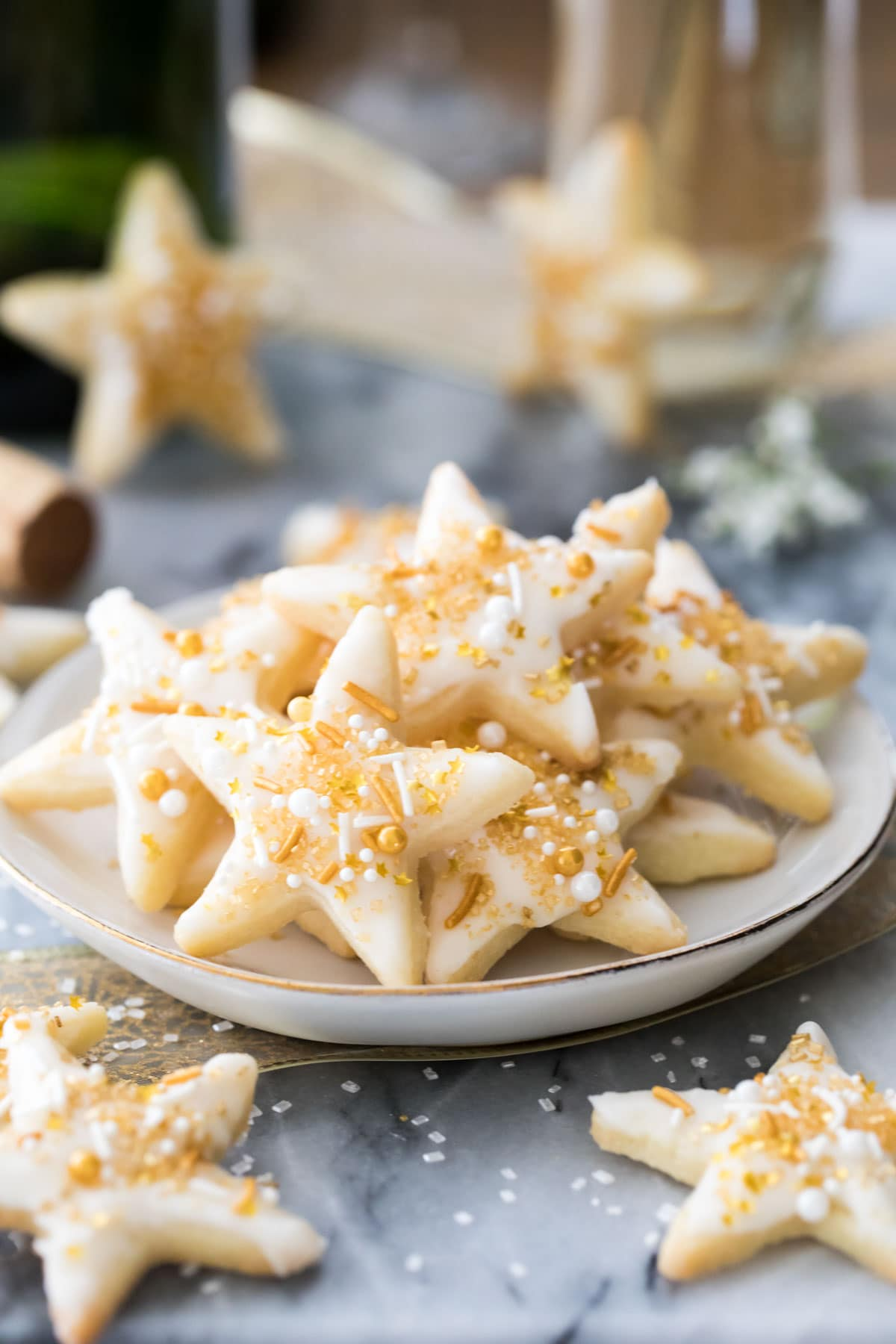 champagne star cookies on a white plate