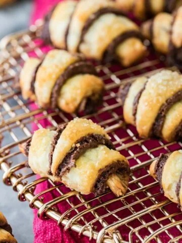 chocolate rugelach arranged on cooling rack