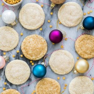 drop sugar cookies on marble surrounded by ornaments
