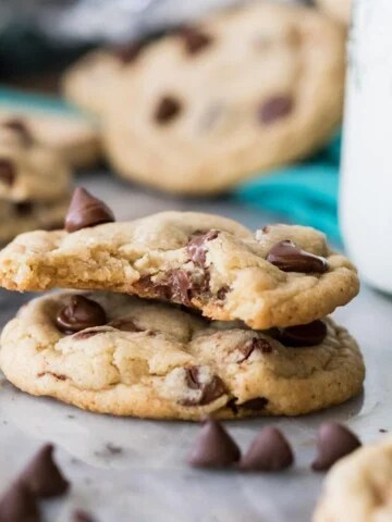 Two eggless chocolate chip cookies, one with a bite missing