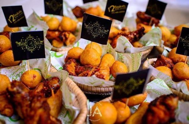 Image result for Nigerian wedding guests eating at a party