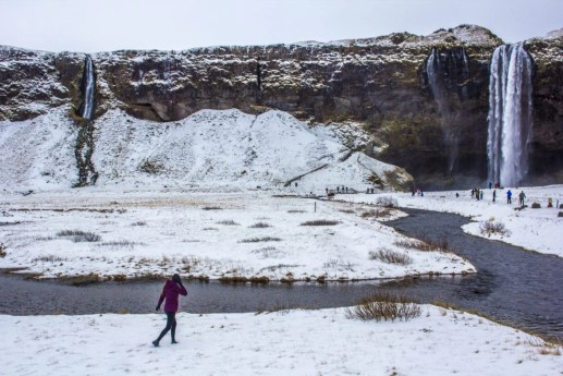 Seljalandsfoss in front of walking waterfall Iceland Solo Female Travel Roadtrip Winter