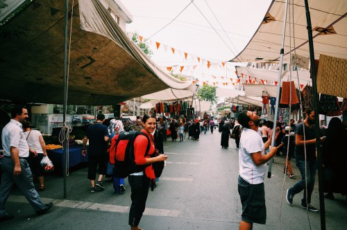 On our way to the airport - couldn't resist a stop at the local street market, backpacks and all