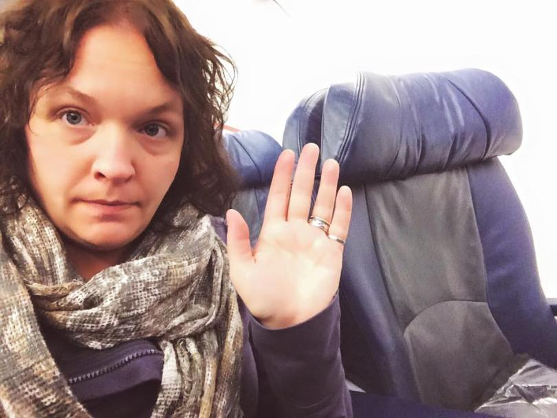 Me, sadly waving goodbye to airline status on my last flight of the year.