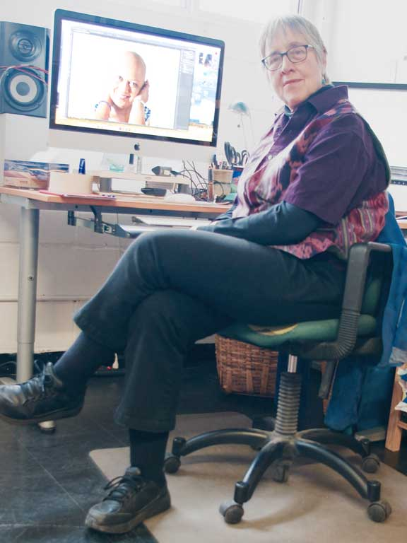Photograph of artist at desk