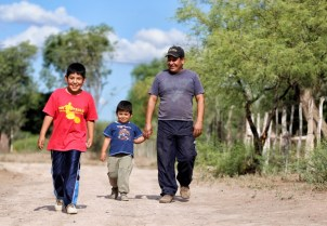 Humberto (right) walking with his two sons, Joaquin (left) and Francisco (centre).