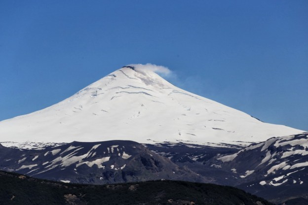 Snow-capped volcanoes dominate the landscape