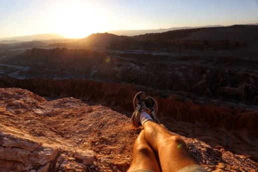 valle de la luna san pedro de atacama sunset legs