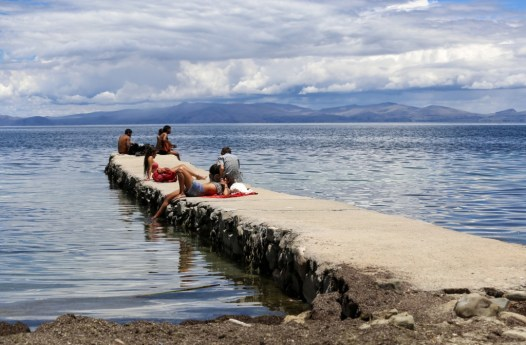 Relaxing on the Sun Island pier on the Lake Titicaca Bolivia