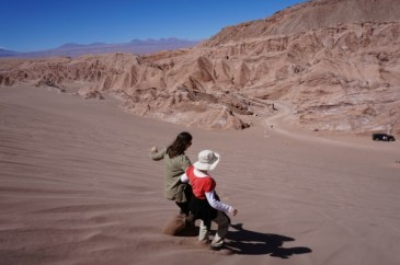 Running down the sandy hills of the Death Valley, Atacama Desert, Chile