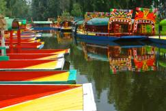 Colourful trajineras on the Xochimilco Canal, Mexico
