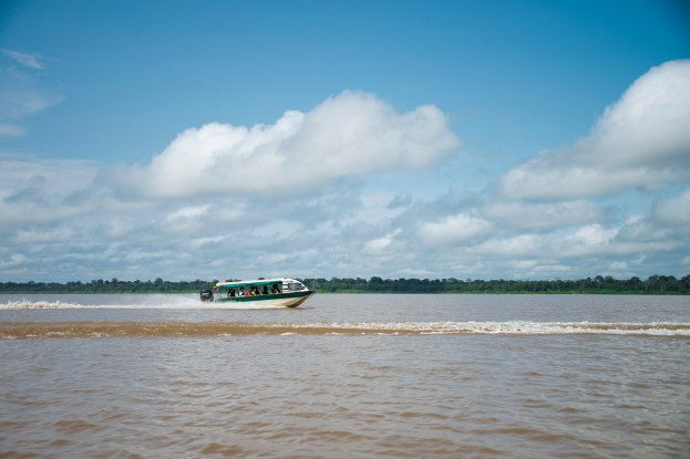 A speedboat cruising through the Amazon river in Colombia