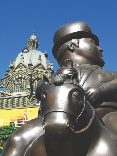 An incredible church in Medellin with a Botero statue infront, Colombia