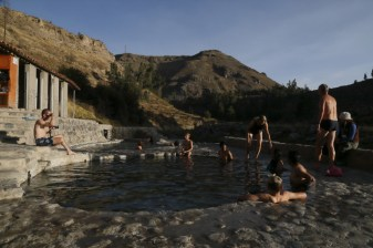 Locals and foreigners relaxing at the hot springs next to the Colca River