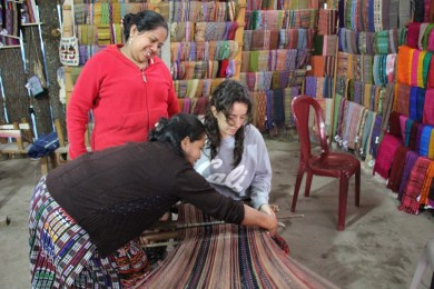 Having weaving lessons during a homestay with women weavers in Lake Atitlan, Guatemala
