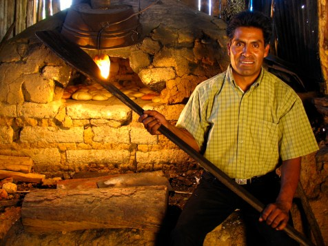 Keeping with the traditions in Latuvi, baking artisan bread for visitors, Oaxaca, Mexico