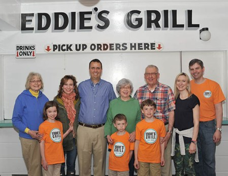 Taking a break at the family restaurant are members of the Sezon family, who own and work at Eddie's Grill at Geneva-on-the-Lake. In the front row are Ellie, Harrison and Graydon Brugger; back row (from left) are Rose Marie Sezon, Marianne Sezon Dana, Richard Dana, Ann and Eddie Sezon, and Jennifer and Garett Brugger, of Erie, Pa.