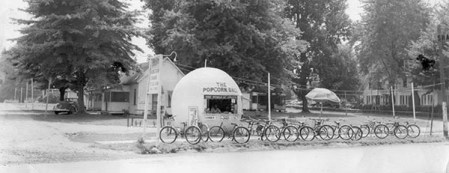 The Popcorn Ball rented bicycles in addition to selling snacks. The ball stood at the west end of The Strip, in the area where the Visitor's Bureau's office is located. It was later moved farther west on the street. The ball was in business during the 1930s.
