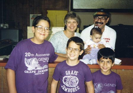 Pam and Tony Capo pause for a photo with their young family in 1987. From left are Tony Jr., Joe and Chris; daughter Alyssa is on the counter.