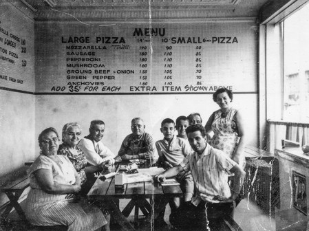 Capo's Pizza is owned by Tony and Pam Capo. This family photograph was made when Tony was just a boy back in New Brighton, Pa. The family had gathered at Capo's Pizzeria in New Brighton. From left are: Tony's grandparents Mary DiCosimo, Jenny Cap, Dominic Capo, August DiCosimo, cousin Chuck Capo, Tony Capo, Chuck Capo (a cousin) Frank Capo (far back), Danny Capo (in front) and Mary Ann Capo, Tony's mother. The year was 1963, two years before Frank and Mary Ann set up shop at Geneva-on-the-Lake.