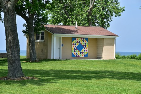 Ocean Waves is the barn quilt on the public restroom facility at Chestnut Grove, east of The Lodge.