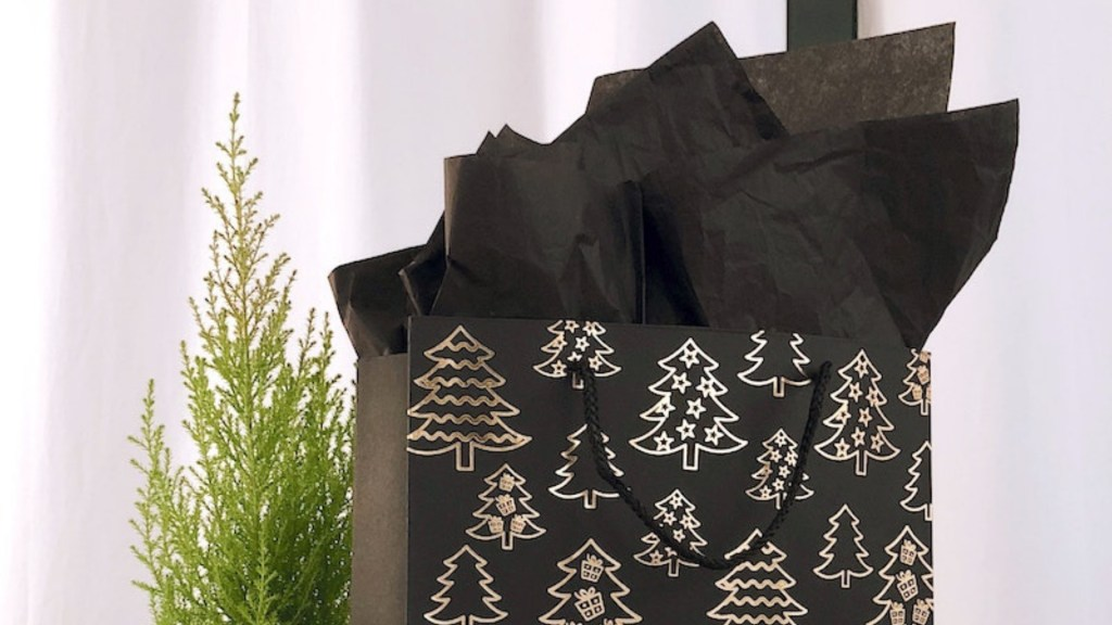 Close up of black and gold holiday gift bag