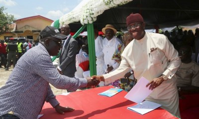 Delta State Governor, Senator Ifeanyi Okowa (right) receiving a letter of address from the Speaker, Delta State House of Assembly, Rt. Hon. Sheriff Oborevwori, during Hon. Oborevwori Constituency Empowerment Program, at Trade Fair Complex, Osubi Okpe Local Government Area, Delta State.