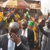 R-L: Vice President, Prof. Yemi Osinbajo and Edo State Governor, Mr. Godwin Obaseki, acknowledging cheers from traders, during the launch of TraderMoni, in Ekiosa Market, Benin City, on Saturday, January 19, 2019