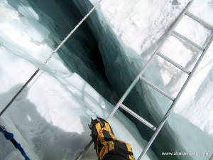 Crossing a ladder in Khumbu Icefall