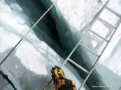 Crossing a ladder in Khumbu Icefall