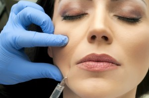 cosmetologist making facial injection