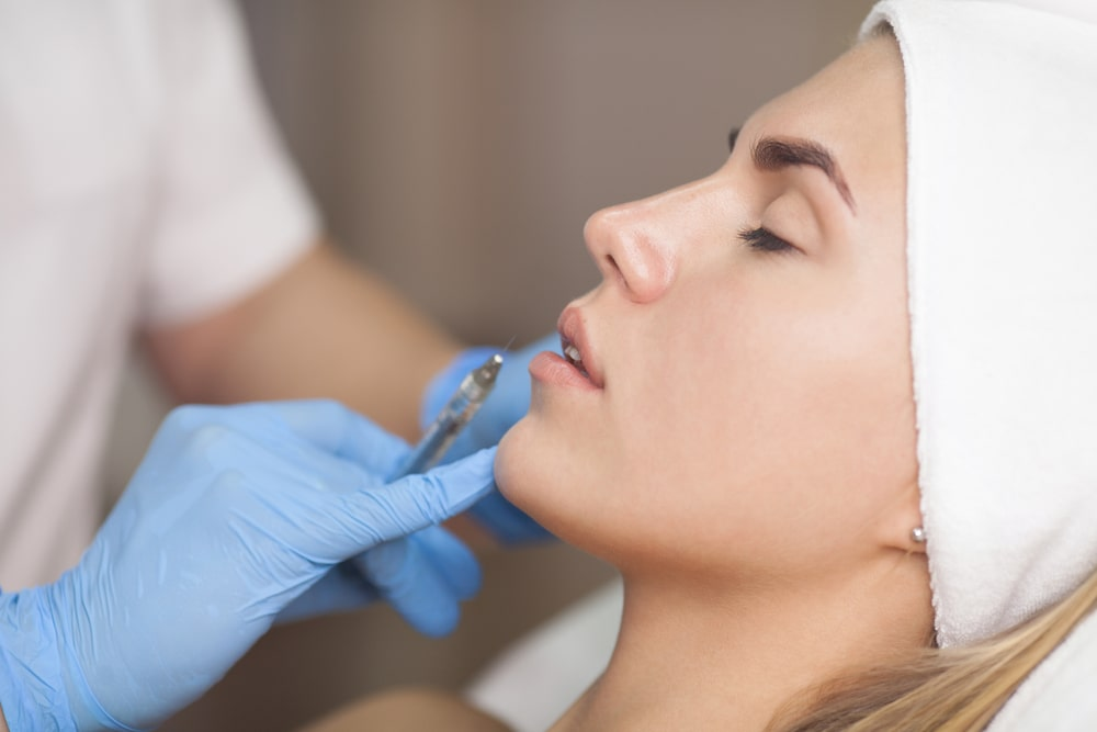 Woman getting facial fillers