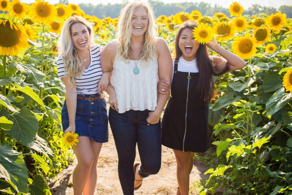friends on a sunflower field