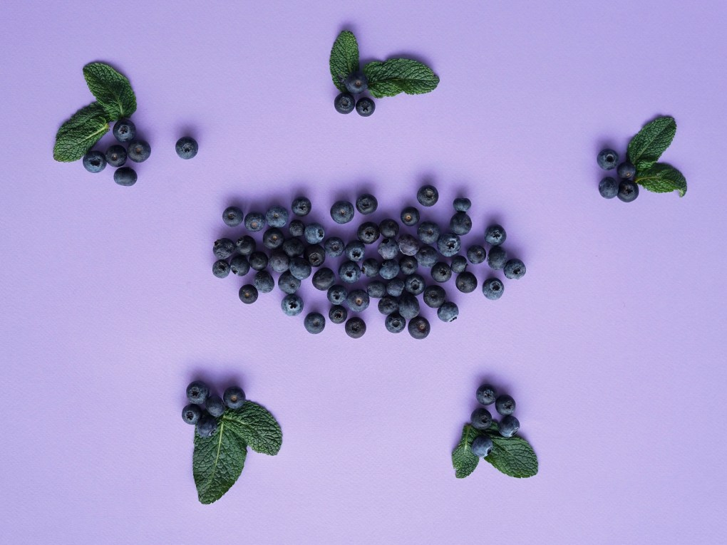 image of grapes in purpple back ground