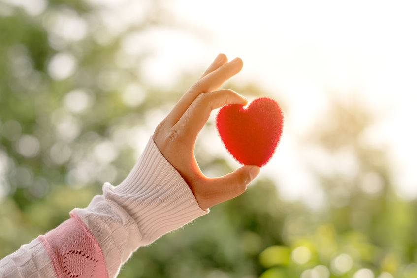 holding a toy heart
