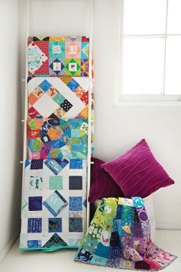 ladder-holding-4-quilts-folded