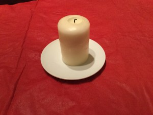 Candle on plate