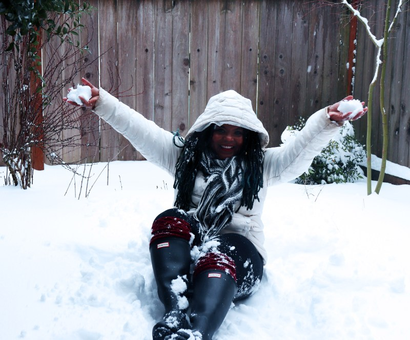 Black woman playing in the snow