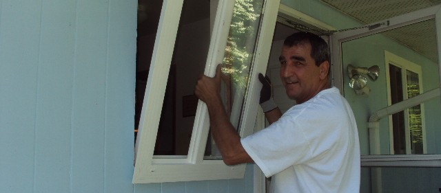 Stefan Zadravec of Sunny Exteriors Installing New Windows