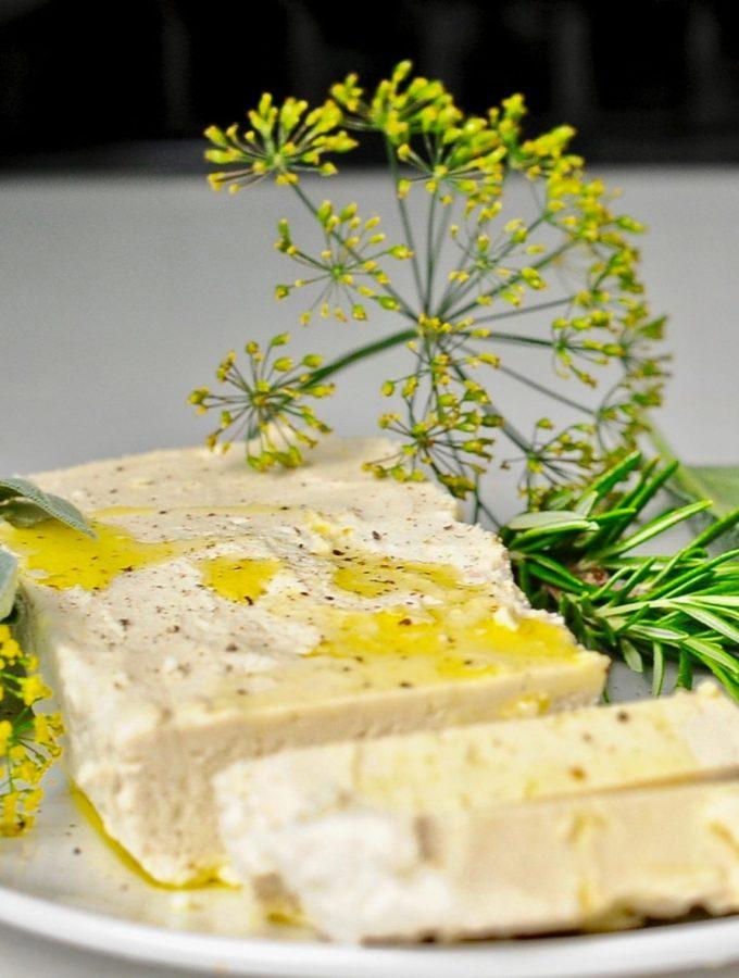 Vegan Almond Feta cheese with fresh herbs.