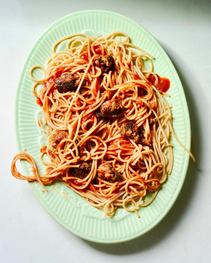 GreenRetro  Platter with twirling spaghetti and sausage chunks.
