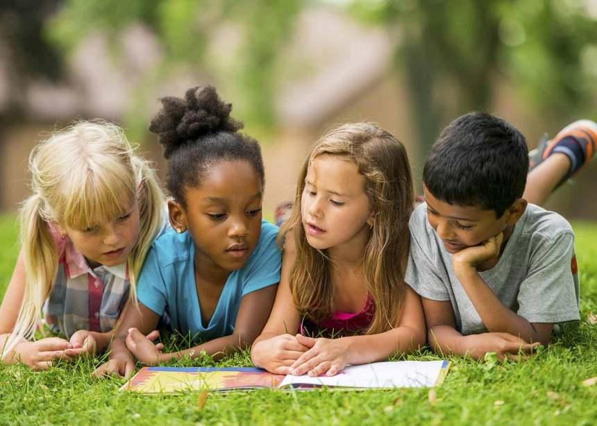children reading books outdoor