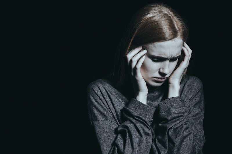 Young woman with depression and anxiety