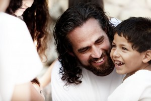 A Child Smiles Standing Close to Christ