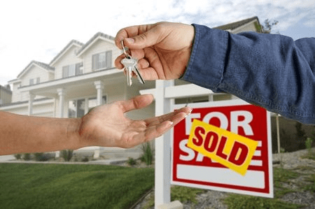 Real estate agents sold home with keys