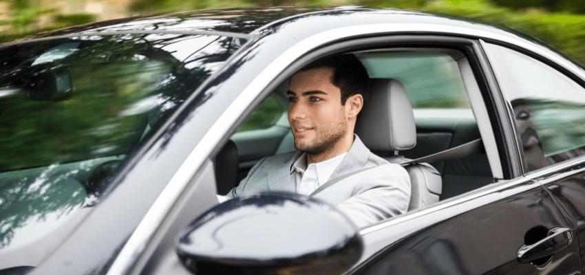 Driving Revenue Through Sales Car - Man Driving