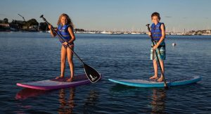 A boy and a girl paddling
