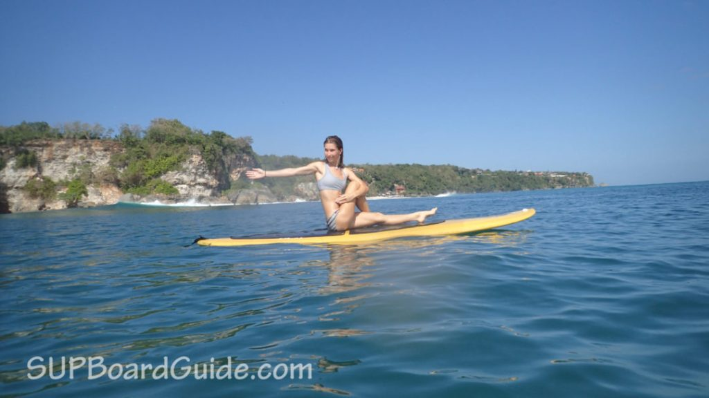 Sarah on her SUP practicing yoga